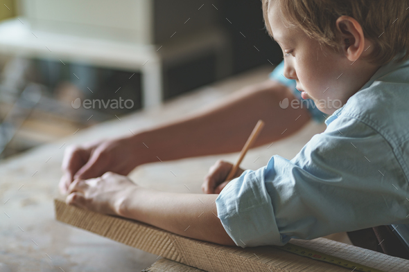 Working father and son - Stock Photo - Images