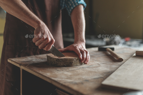 Men's hands with wood - Stock Photo - Images