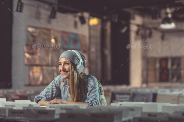 Smiling girl with headphones - Stock Photo - Images