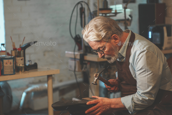 An elderly man at work - Stock Photo - Images