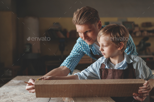 Young father and a little son at work - Stock Photo - Images