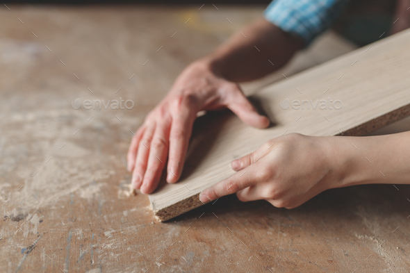 Men's and children's hand holding the board - Stock Photo - Images