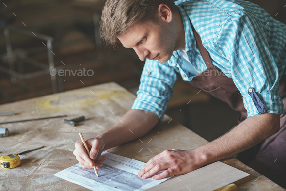 Young master in carpentry - Stock Photo - Images