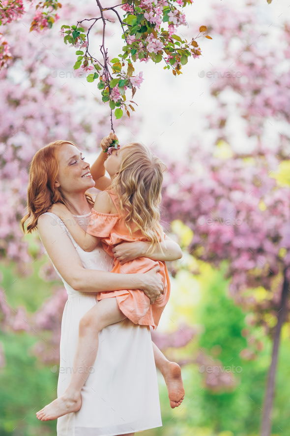 Smiling mother and a little daughter - Stock Photo - Images