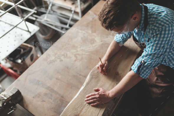 Young carpenter at work - Stock Photo - Images