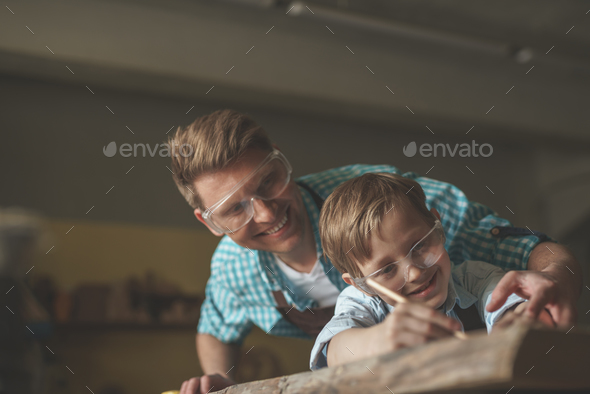 Dad and son at work - Stock Photo - Images
