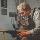 An elderly man in a workshop - PhotoDune Item for Sale