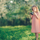 Little girl with a retro camera in park - PhotoDune Item for Sale