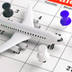 Airplane white and colorful push pins, on a calendar background. 3d illustration. - PhotoDune Item for Sale