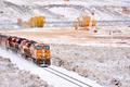 Train transporting tank cars. Season changing autumn to winter. - PhotoDune Item for Sale