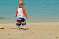 Two year old toddler boy walking on beach - PhotoDune Item for Sale