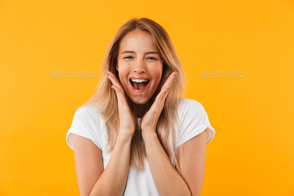 Portrait of an excited young blonde girl screaming - Stock Photo - Images