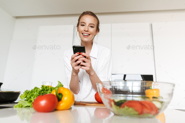 Pretty young woman taking picture - Stock Photo - Images