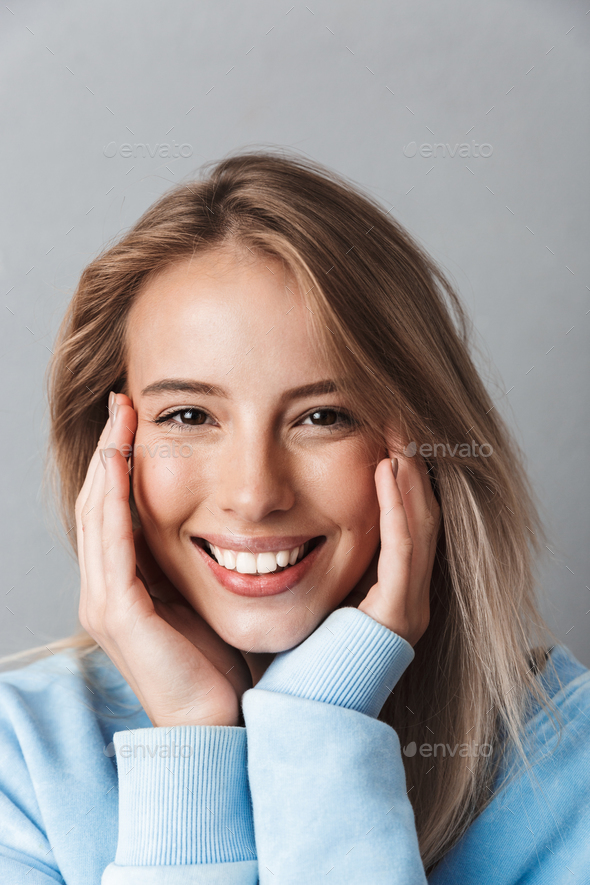Close up of a happy young girl in blue sweatshirt - Stock Photo - Images