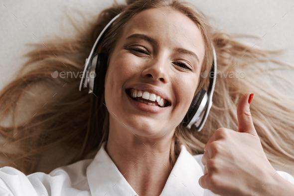 Top view of joyful young woman in headphones - Stock Photo - Images