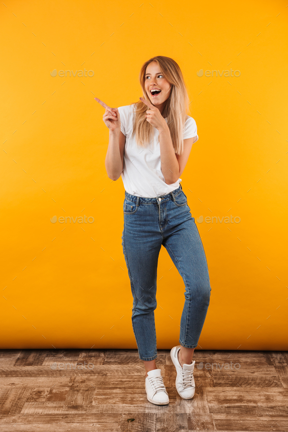 Full length portrait of a joyful young blonde girl - Stock Photo - Images