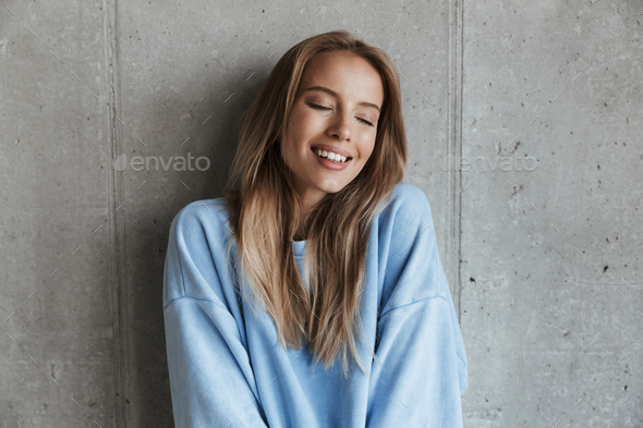 Attractive young woman dressed on white shirt - Stock Photo - Images