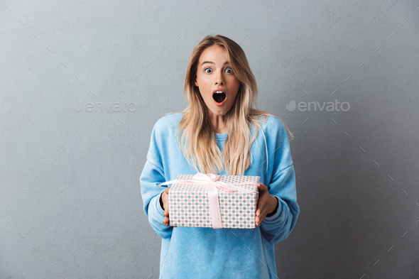 Portrait of an excited young blonde girl - Stock Photo - Images