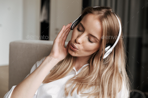Close up of lovely young woman in headphones - Stock Photo - Images