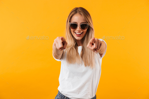 Portrait of a cheerful young blonde girl in sunglasses - Stock Photo - Images