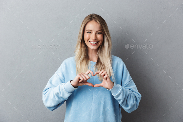 Portrait of a lovely young girl in blue sweatshirt - Stock Photo - Images