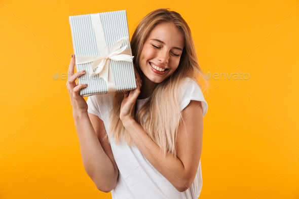 Portrait of a satisfied blonde young woman - Stock Photo - Images