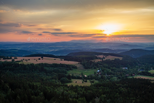 Summer sunset landscape green forest and mountains - Stock Photo - Images