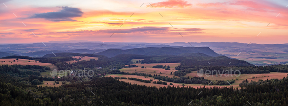 Sunset panorama, inspiring landscape, green forest and mountains - Stock Photo - Images