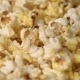 Mixing Hot Popcorn in Heap.  of Fresh Popcorn Flakes. Popping Up Popcorn - VideoHive Item for Sale