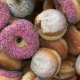 Falling Different Donuts on a Pink Background - VideoHive Item for Sale