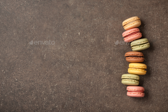 French colorful macaroons on vintage background - Stock Photo - Images