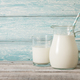 Pitcher and glass of milk on wooden table - PhotoDune Item for Sale