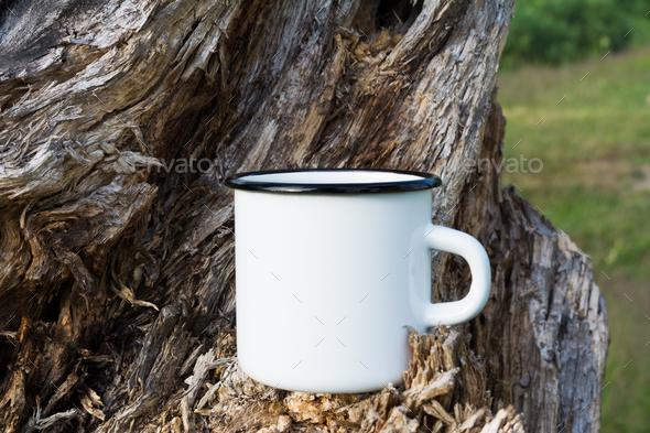 Campfire enamel mug mockup with stump - Stock Photo - Images