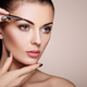 Beautiful brunette woman paints the eyebrows - PhotoDune Item for Sale