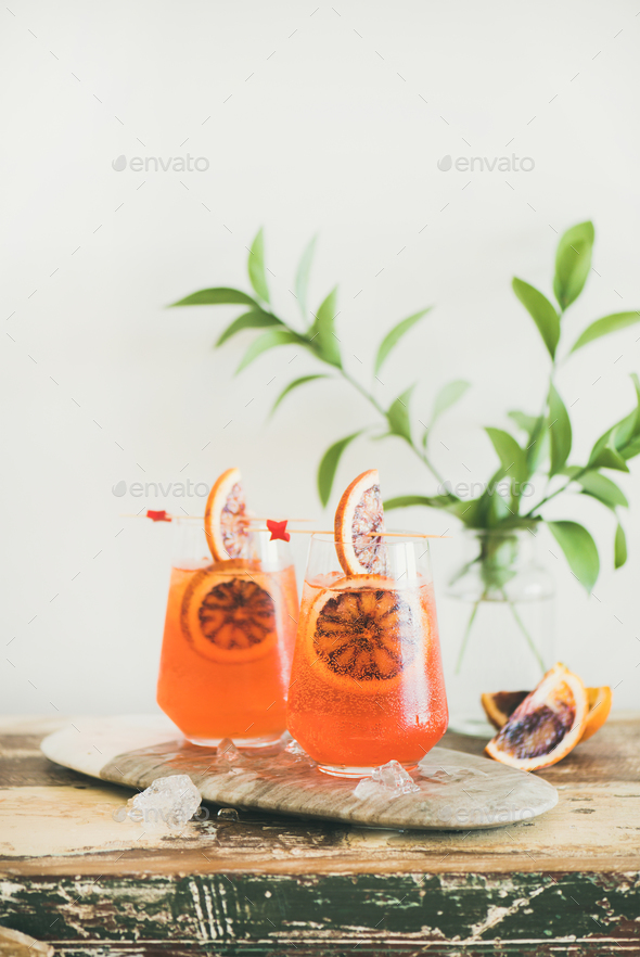 Glasses of Aperol Spritz alcohol cocktail with orange and ice - Stock Photo - Images