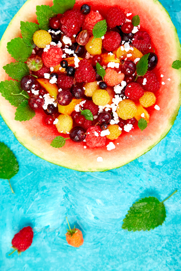 Watermelon bowl with cottage cheese and berries - Stock Photo - Images