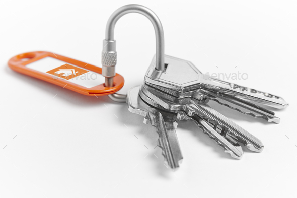 Key ring with keys over white background. Rent, buy - Stock Photo - Images