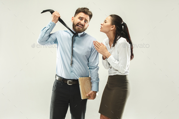 Angry boss. Man and his secretary standing at office or studio - Stock Photo - Images