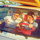 Laughing romantic couple sitting in car while out on a road trip at summer day - PhotoDune Item for Sale