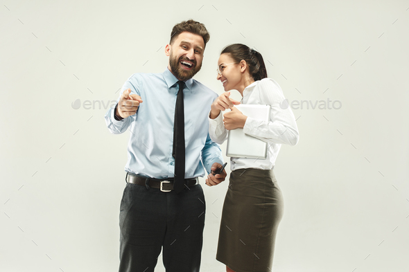 Happy boss. Man and his secretary standing at office - Stock Photo - Images