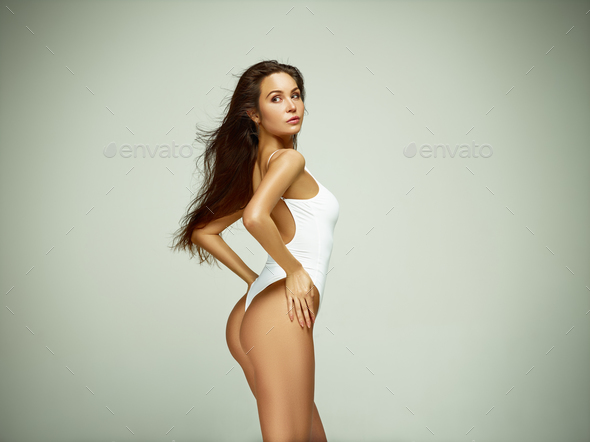 Fit, healthy and sporty girl in swimsuit. Sport, fitness, diet and healthcare concept. - Stock Photo - Images
