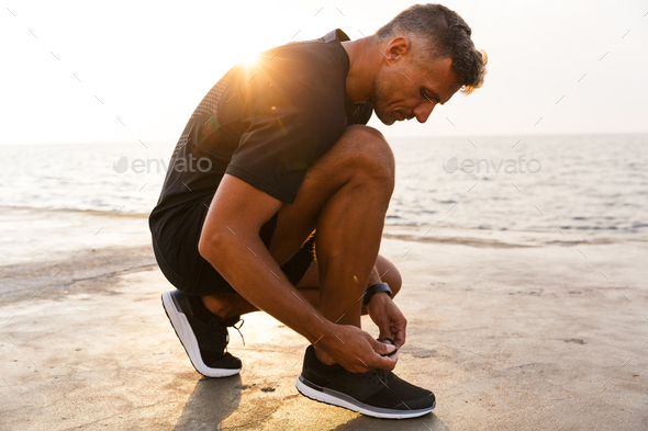 Photo of handsome caucasian man 30s in tracksuit and sneakers sq - Stock Photo - Images