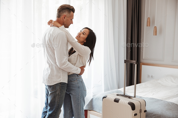Image of multiethnic couple man and woman wearing casual clothin - Stock Photo - Images