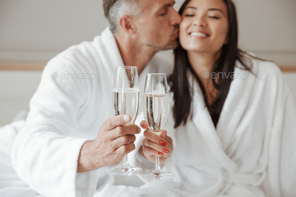 Image closeup of caucasian handsome man kissing beautiful asian - Stock Photo - Images