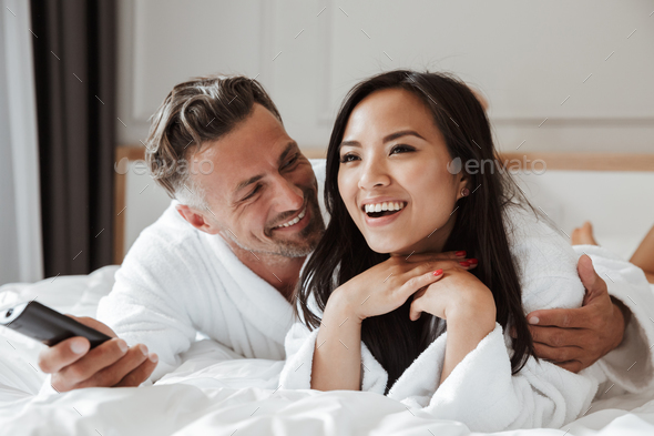 Photo of multiethnic couple caucasian man and asian woman wearin - Stock Photo - Images