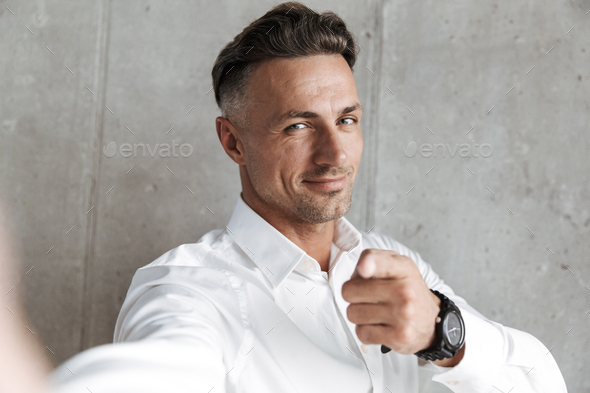 Portrait of a handsome man in white shirt - Stock Photo - Images