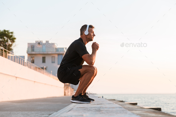Photo of healthy caucasian man 30s in tracksuit warming up and s - Stock Photo - Images