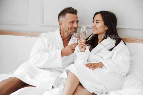 Beautiful couple 30s caucasian man and asian woman wearing white - Stock Photo - Images