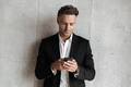 Handsome man dressed in suit holding mobile phone - PhotoDune Item for Sale