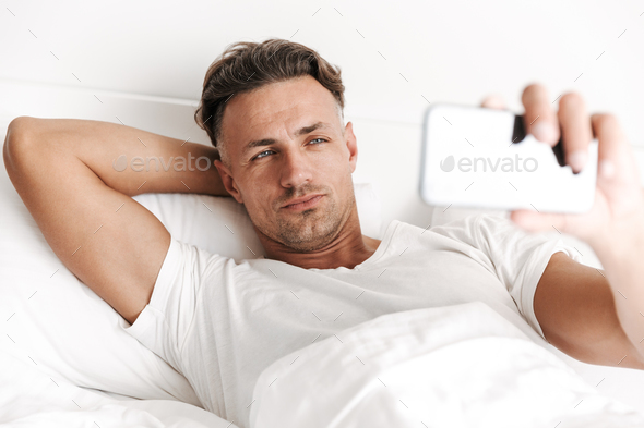 Close up of handsome man taking a selfie - Stock Photo - Images